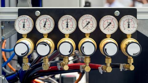 An image showing a manometer, pressure gauge and valves