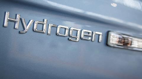 An image showing hydrogen writing in relief on car