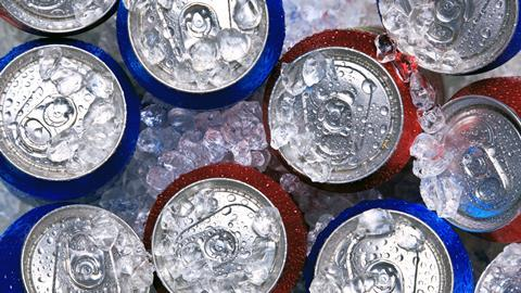 Cans of fizzy drinks on ice