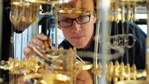IBM commercial quantum computer, showing IBM scientist Stefan Filip - Hero