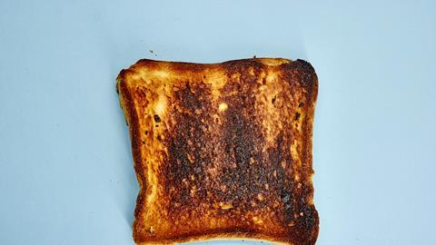 Burnt toast on a blue background