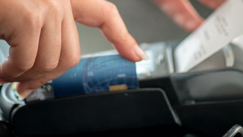 Someone using a card payment machine