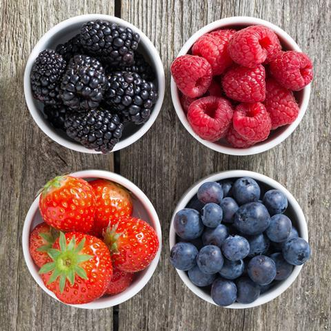 Assorted berries in dfiferent fruit bowls