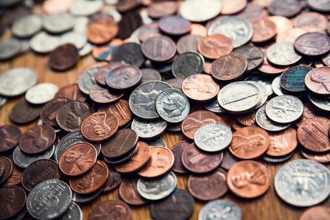 US coins: quarters, pennies and nickels.