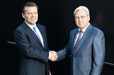 Hariolf Kottmann, CEO of Clariant, shaking hands with Peter Huntsman, President and CEO of Huntsman