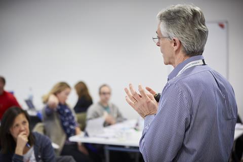 A man delivers a talk at a workshop