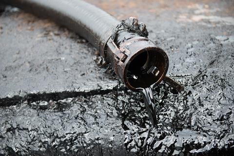 Crude oil spilling out from a tube