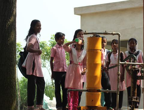AMRIT drinking water purification unit using nanomaterials connected to a hand pump  installation in a school