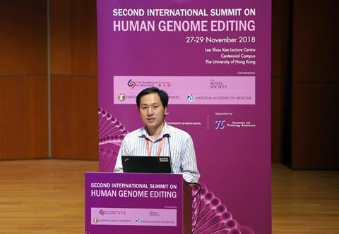 An image of He Jiankui at the Second International Summit on Human Genome Editing