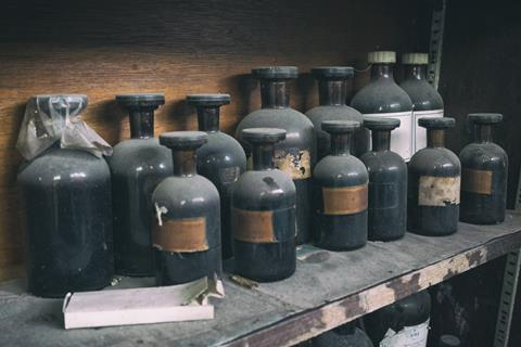 Antique, dusty chemical bottles