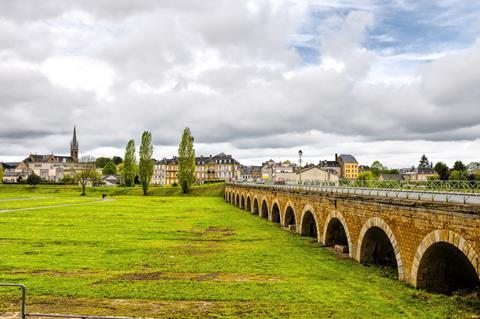 View of old houses and bridge in city of Sedan, France