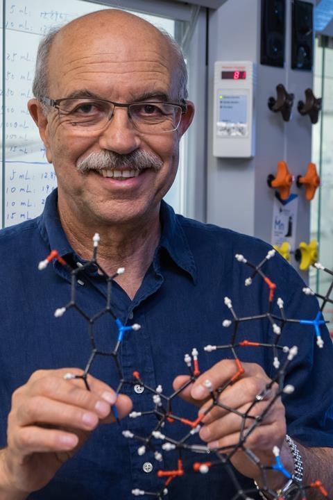 Synthetic chemist K.C. Nicolaou holds a model of shishijimicin A