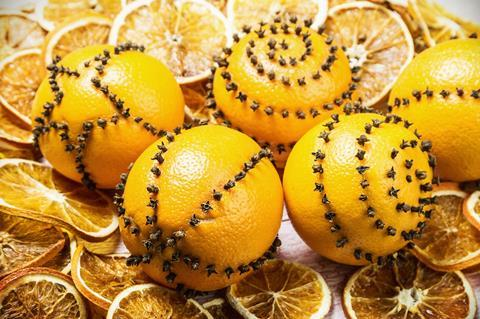 Oranges studded with cloves as Christmas decorations