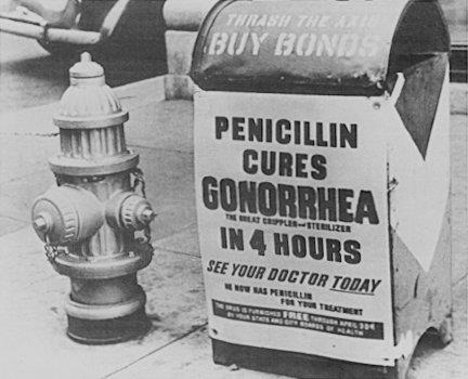 A poster attached to a curbside mailbox offering advice to World War II servicemen: Penicillin cures gonorrhea in 4 hours.