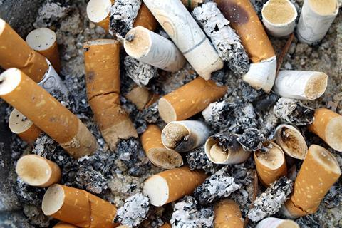 Ashtray full of used cigarette butts