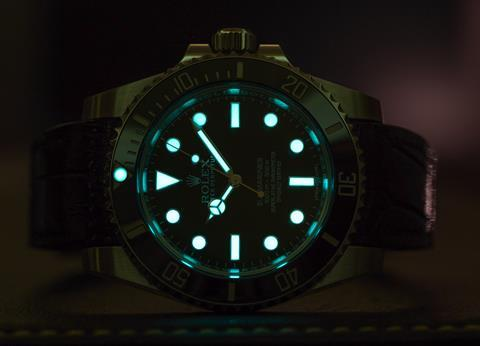 Rolex submariner, dial glowing in the dark