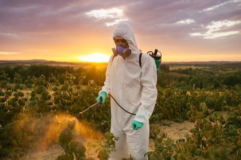 Man spraying toxic pesticides or insecticides
