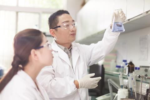Chinese research scientists in laboratory