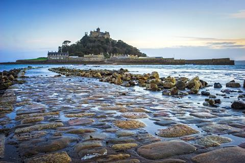 Dusk on the causeway leading to St Michaels Mount off the coast of Marazion Cornwall England UK