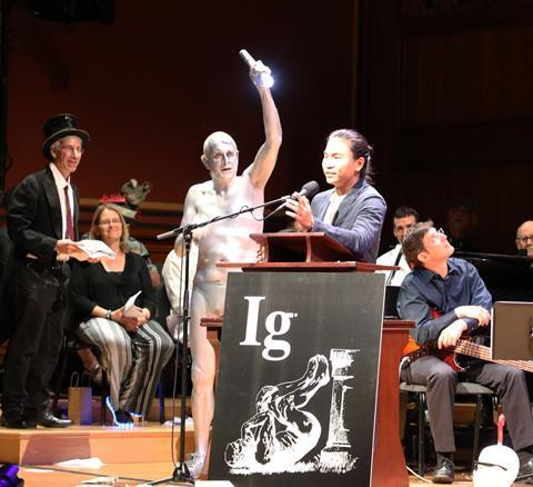 A photograph of Jiwon Han receiving an Ig Nobel prize