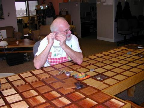 An image showing Theodore Gray sitting in front of a table formed of periodic table tiles