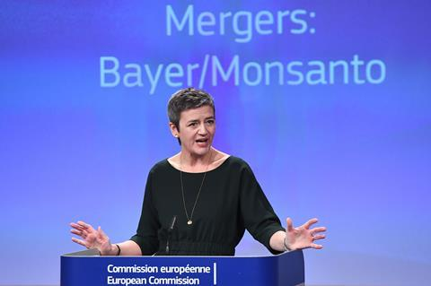 A picture of Margrethe Vestager at a press conference on the Bayer/Monsanto Merger