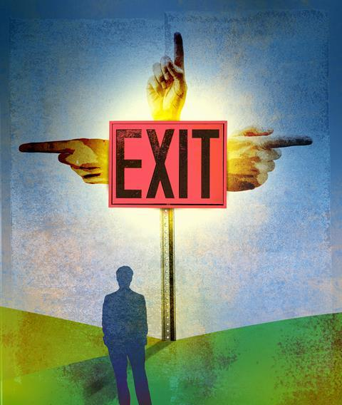 Man in front of a sign pointing three different ways to Exit