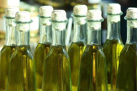Home-made olive oil in bottles on a market