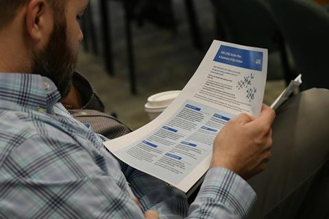 An image showing a man holding a piece of paper which highlights EPA's PFAS action plan