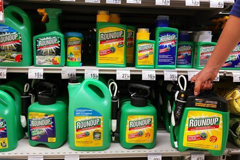 Shelves with a variety of Herbicides in a Carrefour Hypermarket. Roundup is a brand-name of an herbicide containing glyphosate, made by Monsanto Company.