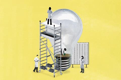 An image showing scientists planting a seed inside a giant light bulb