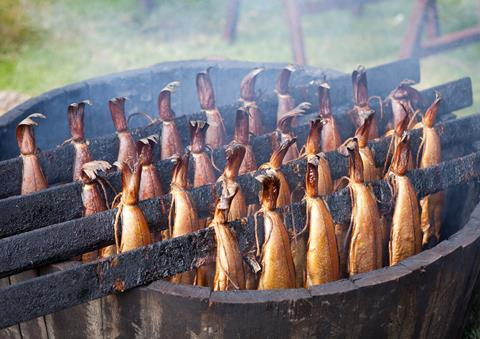 A photograph of Arbroath smokies on a traditional wooden smoker