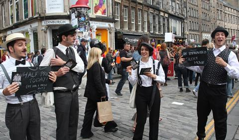 A photograph of festival performers promoting their show