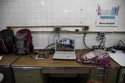 An image showing a laptop and backpacks sitting inside the chemistry lab at the Simon Bolivar University campus in Caracas, Venezuela