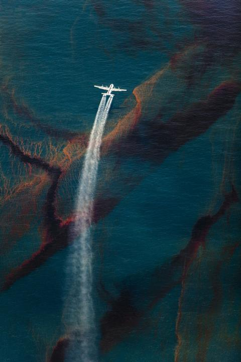 A C-130 plane spraying dispersant at the Deepwater Horizon oil spill in the Gulf of Mexico, May 2010.