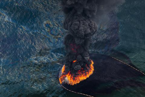 A plume of smoke rises from the burn of collected crude oil spilled from the burst well head of the Deepwater Horizon in the Gulf of Mexico in May 2010.