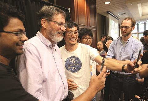 George P. Smith taking selfies with students at the University of Missouri