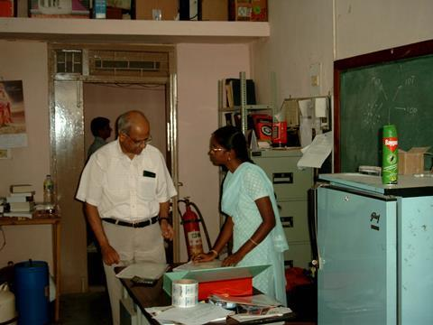 Desiraju in a lab with a colleague