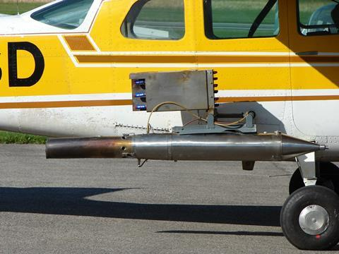 Cessna 206, rebuilt for cloud seeding, with detail view of silver iodide generator