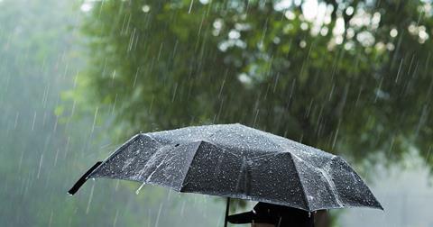 Heavy rain on a black umbrella