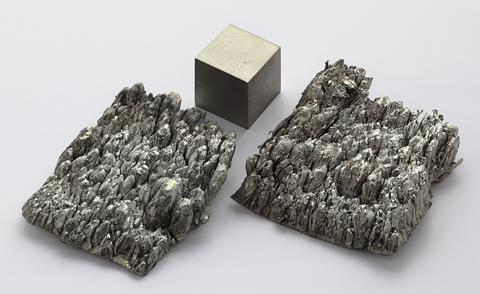 Scandium, sublimed-dendritic, high purity 99.998% Sc/TREM. As well as an argon arc remelted 1cm^3 scandium cube for comparison.