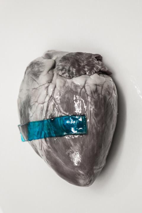 A blue strip of 'slug glue' on a heart
