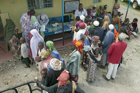 People queuing for medicines, Africa