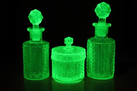 Art deco molded green uranium glass fluoresces under UV light