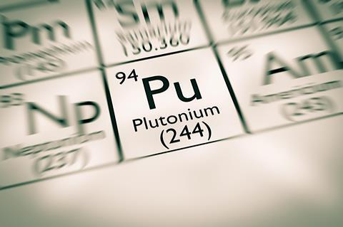 An image in soft focus, showing the element plutonium on the periodic table