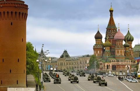 A military parade passes St Basil's cathedral, Red Square, Moscow