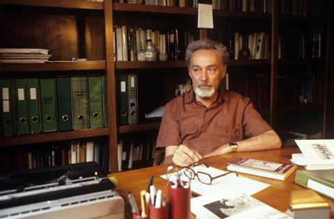 An image showing Primo Levi at his desk