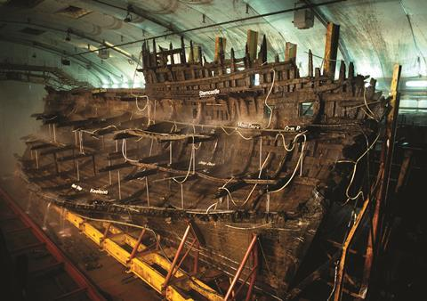 The hull of the Mary Rose, being preserved in a museum