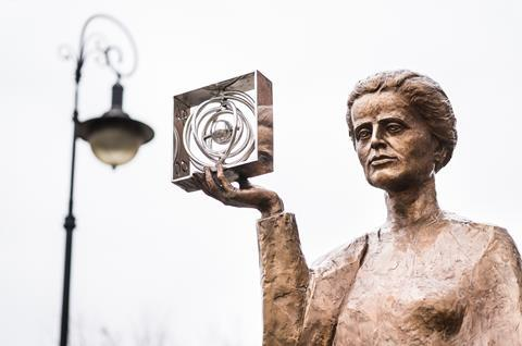 WARSAW, POLAND - JANUARY 2, 2014: Sculpture of Marie Sklodowska-Curie by polish sculptor Bronislaw Krzysztof. The Nobel prize winning scientist is holding a graphic symbol of Polonium in her hand