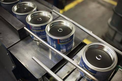 A photograph of Sikkens paint cans